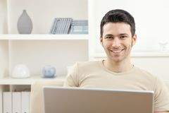 Man with laptop computer at home royalty free stock photo