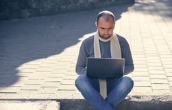 Man with the laptop computer outdoors. Portrait of a man with the laptop computer outdoors Royalty Free Stock Photo