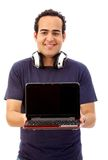 Man with laptop and earphones Royalty Free Stock Photography