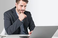 Man with laptop, face recognition royalty free stock images