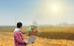 Man with laptop in the field Royalty Free Stock Photos