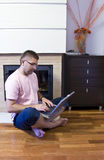Man with laptop on floor Royalty Free Stock Photography
