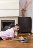 Man with laptop on floor Royalty Free Stock Image