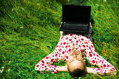 Man with laptop on grass Royalty Free Stock Photography