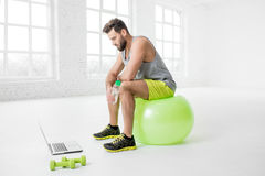 Man with laptop in the gym Stock Photos