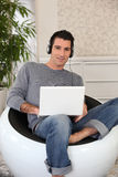 Man with laptop and headset Royalty Free Stock Photos