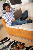 Man on a laptop at home Royalty Free Stock Images