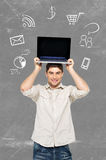 Man with laptop and icons around computer Stock Image