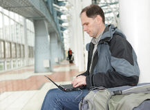 Man with laptop indoors Stock Images
