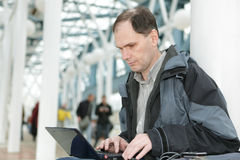 Man with laptop indoors Stock Photography