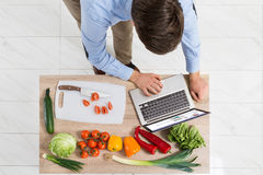 Man With Laptop In Kitchen Stock Image