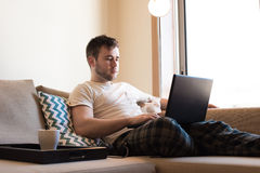 Man with laptop at living room Royalty Free Stock Image