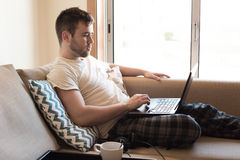 Man with laptop at living room Royalty Free Stock Photo