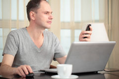 Man with laptop and mobile phone Royalty Free Stock Photography