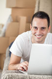 Man with laptop in new home Stock Photo