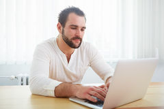 Man with laptop in the office Royalty Free Stock Photo