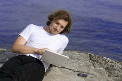 Man with a laptop in an outdoor Royalty Free Stock Photo
