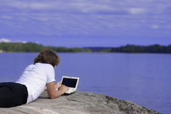 Man with a laptop in an outdoor Stock Image