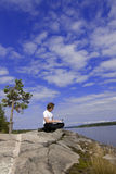 Man with a laptop in an outdoor Stock Images