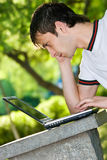 Man with laptop outdoor portrait Stock Photography