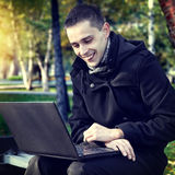 Man with Laptop outdoor Stock Images