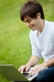 Man with a laptop outdoors Royalty Free Stock Image