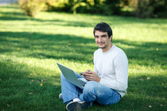 Man with laptop outdoors Stock Photos