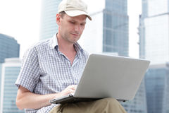 Man with laptop outdoors Royalty Free Stock Image