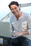 Man on laptop outside Stock Photos