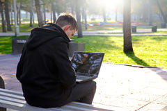 Man with Laptop in the Park Royalty Free Stock Photo
