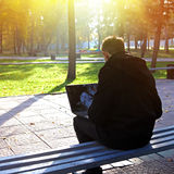 Man with Laptop at the Park Stock Photos