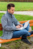 Man with laptop in the park Stock Photography