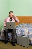 Man with laptop on phone Stock Photos
