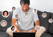 Man on laptop with Profile portraits of people contacts Stock Photo