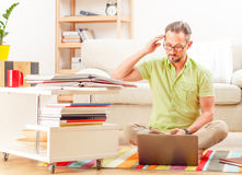 Man on laptop running business from home Royalty Free Stock Image