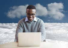 Man on laptop in sea of documents under sky clouds. Digital composite of man on laptop in sea of documents under sky clouds Stock Photos