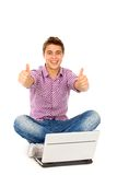 Man with laptop showing thumbs up Royalty Free Stock Photography