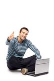Man with laptop showing thumbs up Royalty Free Stock Images