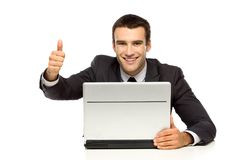 Man with laptop showing thumbs up Royalty Free Stock Photos