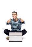 Man with laptop showing thumbs up Royalty Free Stock Image