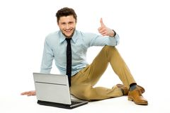 Man with laptop showing thumbs up Stock Photos