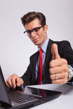 Man at laptop, showing thumbs up Stock Photos