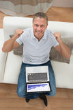 Man With Laptop Sitting On Sofa Stock Image