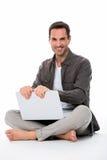 Man with laptop smiling at camera Royalty Free Stock Photos