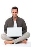 Man with laptop smiling at camera Royalty Free Stock Photos