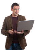 Man with laptop smirking Royalty Free Stock Photography
