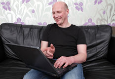 Man laptop sofa happy Stock Photo