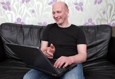 Man laptop sofa happy stock photo