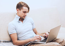 Man with laptop on sofa at home work Royalty Free Stock Image