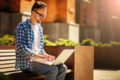 Man with laptop in the street stock image
